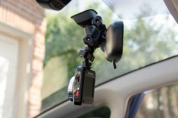 Mirror clamp locks onto your rear view mirror arm.